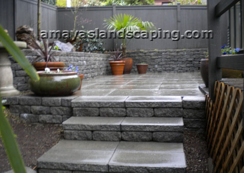 Patio with retaining wall and steps.