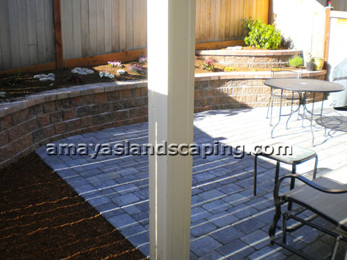 Patio with multi-level curved retaining wall.